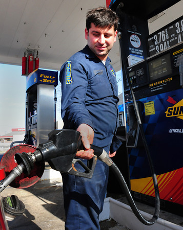 Newburyport: Attendant Kassem Trad pumps gas at the Sunoco on Storey Avenue in Newburyport yesterday afternoon. Bryan Eaton/Staff Photo