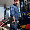 Newburyport: Attendant Kassem Trad pumps gas at the Sunoco on Storey Avenue in Newburyport yesterday afternoon. Bryan Eaton/Staff Photo
