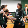 West Newbury: Pentucket girls basketball assistant coach Amy Beaton with the team as they warm up for practice last night. Bryan Eaton/Staff Photo