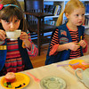 Newburyport: Daisy Troop 85333 held a tea at the Emma Andrews Library where they meet for their activities, this week to celebrate Girl Scouting's 100th anniversary. Using their manners as they sip and eat fruit salad and a cupcake is Elizabeth Metsker, left, and Janie Turgeon, both 6.