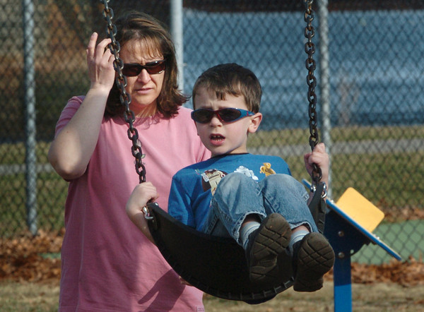 Newburyport: Bodhi DePaolo, 5, of Newburyport spent some time at the playground with his mother, Heather, at Cashman Park on Monday afternoon. Many people were out there, despite a cooling wind from the east. Bryan Eaton/Staff Photo