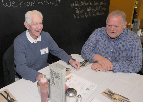 Amesbury: Veteran George Roaf and his son in law Allen Frost share a laugh  at a breakfast for World War 2 veterans and their families at the Hollow Cafe in Amesbury Friday morning. Jim Vaiknoras/staff photo