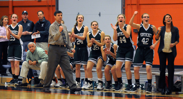 Beverly: Pentucket coach John McNamara and his bench cheer as the Sachems take a lead over Swampscott during their tournament game  at Beverly High Thursday night. Jim Vaiknoras/staff photo