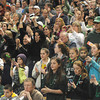 Worchester:freinds and family of  the Pentucket High girls basketball team wave and take photos after their victory over Sabis in the State Championship at the DCU arena in Worchester.Jim Vaiknoras/staff photo