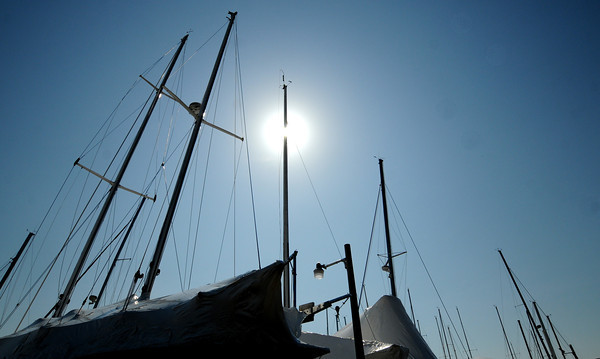 Newburyport: A bight warm sun shines on boats still cover in dry dock at the Windward Yacht Club in Newburyport Sunday afternoon> JIm Vaiknoras/staff photo