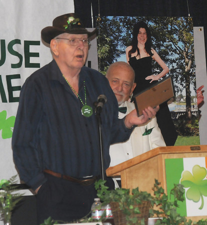 Newburypoprt: Larry Quinn accepts the Irishman of the year from Nick Costello at the Link House St. Patrick's breakfast at the Masonic Temple in Newburyport. jim vaiknoras/staff photo
