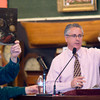 Amesbury: Auctioneer John McInnis takes bids on a 16/17 century Dutch still life at his auction house in Amesbury Friday. The painting sold for $190,000. JIm Vaiknoras/staff photo