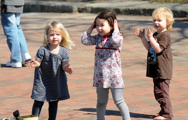 Newburyport: Charlette O'Brien, Emery and Jake Lively dance in Market Landing Park in Newburyport on a warm Sunday afternoon. Jim Vaiknoras/staff photo