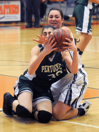 Beverly: Swampscott's Ara Talkov fight for the ball with Pentucket's Tess Nogueira during their tournament game at Beverly High Thursday night. Jim Vaiknoras/staff photo