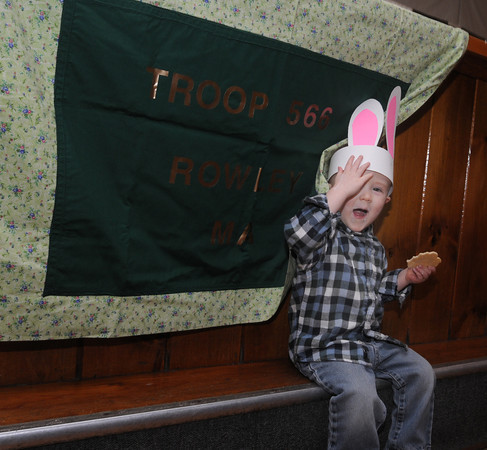 Rowley: Bryce Porter, 2, of Rowley tries to hide as he eats a cookie at the Bunny Hop at Carriage Pines in Rowley . The event was hosted by Rowley Girl Scout Troop 60566, featuring a visit from the Easter Bunny, food, face painting and arts and crafts.JIm Vaiknoras/staff photo