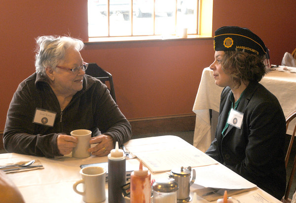 Amesbury: Navy veteran June Knox talks with Veterans agent Kristin Lucier at a breakfast for World War 2 veterans and their families at the Hollow Cafe in Amesbury Friday morning. Jim Vaiknoras/staff photo