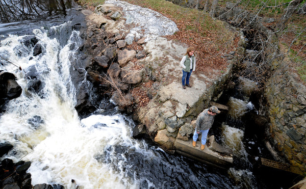 Newbury: Amy Madden and her son Max watch for alewives at the fish ladder in the Parker River near Central Street in Newbury. Jim Vaiknoras/staff photo