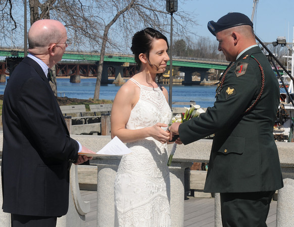 Newburyport: SPC Travis Souther and Marissa Games are married by Justice of the Peace Richard Jones in front of friend and family at Market Landing Park Friday. Travis is being deployed later this spring. JIm Vaiknoras/staff photo