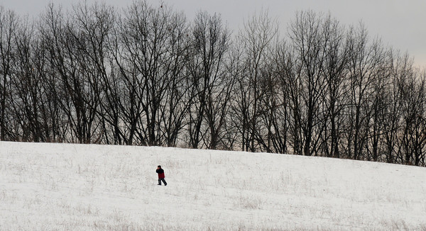 Amesbury: A child takes a long walk back up the hill at a snow covered Woodsom Farm Sunday afternoon. With the weather getting warmer through out the week Sunday may have been the last chance to sled. Jim Vaiknoras /staff photo