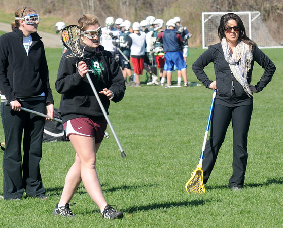 West Newbury: Pentucket girls lacrosse Rachel Abdulla works with her team at Pipe Stave Hill in West Newbury, Jim Vaiknoras/staff photo