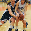 Beverly: Swampscott'sMarina Padovani fight for a loose ball with  Pentucket's Lelsie McNamara during their tournament game at Beverly High Thursday night. Jim Vaiknoras/staff photo