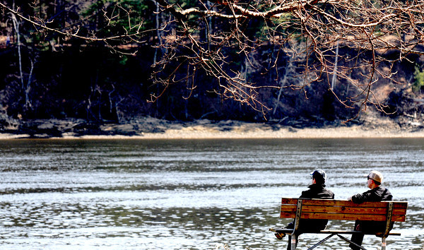 Amesbury: Two men take advantage of the warm weather to watch the Merrimack River go by in Alliance Park in Amesbury Sunday afternoon. Jim Vaiknoras/staff photo