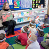 "Newburyport: Cindy Johnson reads "" My Many Colored Days"" by Dr Suess to Julie Carroll's kindergaten at the Brown School in Newburyport. A number of people from the community came by the school to read to students in celebration of Dr Suess's birthday. JIm Vaiknoras/staff photo"