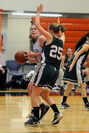 Beverly: Swampscott's Caroline Murphy makes a move inside on Pentucket's Leigh McNamara during their tournament game at Beverly High Thursday night. Jim Vaiknoras/staff photo