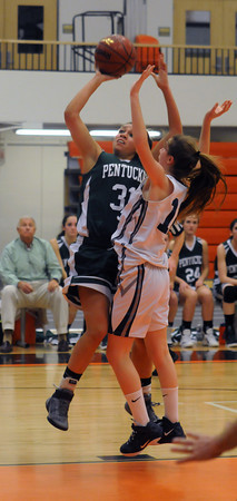 Beverly: Pentucket's Sarah Higgins goes up strong for two during their tournament game against Swampscott at Beverly High Thursday night. Jim Vaiknoras/staff photo