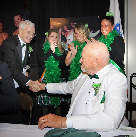 """Newburyport: Charlie Cullen shakes hands with executive director of the Link House Nick Costello after singing """" Thanks for the Memories"""" to him at the annual St Patrick's Day Lunch at the Masonic Temple to benifit the Link House. Jim Vaiknoras/staff photo"""