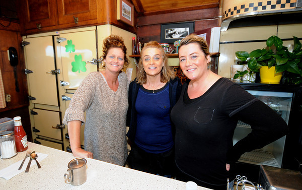 "Salisbury: Sisters Rhonda Griffin, Mabel Lewis and Wendy Merril pose in their diner the ""Fish Tale"" on it's last day Sunday. Jim vaiknoras/staff photo"
