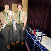 Byfield: Shaun, left, and twim brother Brendan Wallace get their Eagle Scout badges at a ceremony at the  Byfield Grange Sunday. The boys are currently attending Unity College in Unity Maine. Brendan is studying environmental science in hopes of being an evironmental police officer and Shaun is studying marine biology. Jim Vaiknoras/staff photo