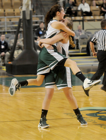 Worchester:Pentucket's Alex Moore and Emily Dresser hug after the Sachem's victory over Sabis in the State Championship at the DCU arena in Worchester.Jim Vaiknoras/staff photo