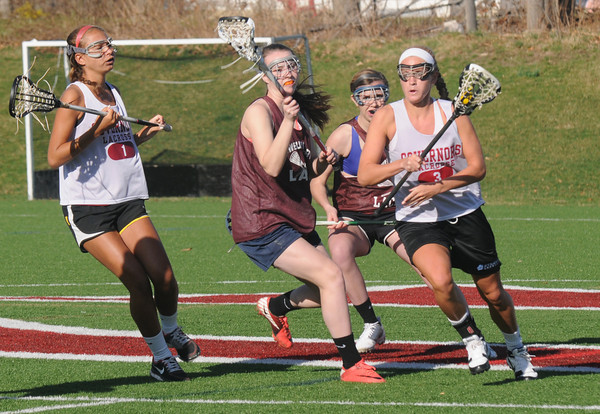 Byfield: Lilly Donovan makes a move during a scrimage against The Governor's Academy Friday afternoon in Byfield. Jim Vaiknoras/staff photo