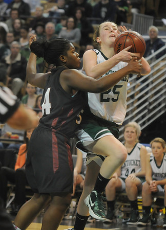 Worchester:Pentucket 's Leigh McNamara is fouled by Sabis' Shyanna Wellington during the Sachem's  victory over Sabis in the State Championship at the DCU arena in Worchester.Jim Vaiknoras/staff photo
