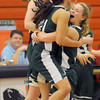 Beverly: Pentucket's Sydney Snow hugs teammate Sarah Higgins after their victory over Swampscott in their tournament game at Beverly High Thursday night. Jim Vaiknoras/staff photo