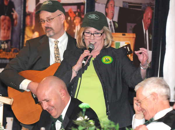 Newburyport:State Rep  Mike Costello laughs as Ann Ormound and Ed Cameron sing to Charlie Cullen at the annual St Patrick's Day Lunch at the Masonic Temple to benifit the Link House. Jim Vaiknoras/staff photo