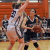 Beverly: Pentucket's Tess Nogueira makes a move on Swampscott's Caroline Murphy during their tournament game  at Beverly High Thursday night. Jim Vaiknoras/staff photo