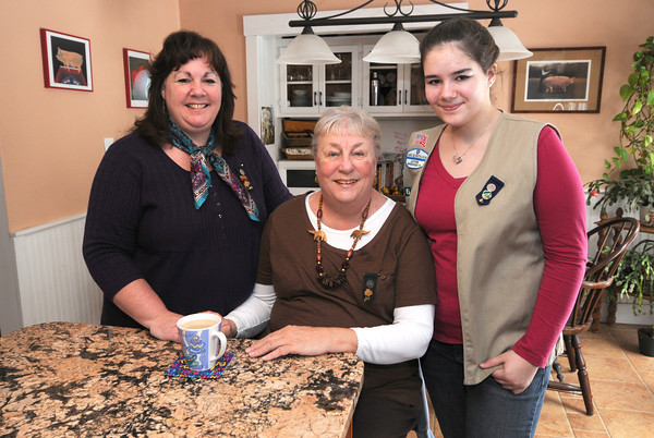 Byfield, Three generation of Girl Scouts, gandmother Karen Boxell, in the middle, mom Kit Lawson on the left and daughter Alyssa Lawson, at the Lawson house in Byfield. Jim Vaiknoras/staff photo