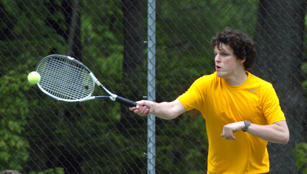 Newburyport: Newburyport's Gage Foley returns a shot is first doubles with teammate AJ MacDougall. Bryan Eaton/Staff Photo