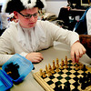 Amesbury: Fifth-graders at the Amesbury Middle School held their annual Colonial Day dressed in period costume and doing activities based on that period. Derek Beaupre, 11, learned what it was like to play games before the advent of electricity as he plays chess with Liam Healy, 11.