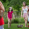 "Newburyport: Time out was called between Amesbury at Newburyport softball at Perkins Field for the old baseball cry ""dog on the field"" as Amesbury's Jenna Bartley tries to help catch Riley. The terrier got off the leash of owner  Victoria Kowalczyk, 6, left, and her baby sitter Kristina Gourley. Bryan Eaton/Staff Photo"