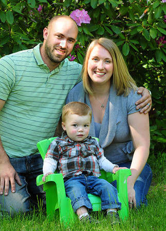 "Merrimac: Lucas McGowan, 18 months, is flanked by his parents Bill and Becky McGowan of Merrimac. The family is raising funds for their child, ""Lucas the Lionheart"" who was born without a left ventricle in his heart. Bryan Eaton/Staff Photo"
