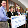 Newburyport: The Newburyport Bank has donated $400,000 to a charitable foundation for local and high school sports named for former bank president Richie Eaton, center. From left, Pentucket High athletic director Daniel Thornton, Janice C. Morse, bank president and CEO, Eaton, Triton High athletic director Donna Andersen and Tim Felton, bank senior vice president and treasurer. Bryan Eaton/Staff Photo