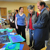 Newburyport: River Valley Charter School art instructor K. Lee Mock shows off some of her students' art work on Friday. They were holding an Open House and Grandparents Day open also to parents, prospective families and interested community members. Bryan Eaton/Staff Photo