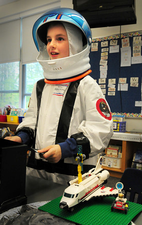 Salisbury: Andrew Warren, 8, takes on the persona of Neil Armstrong, the first man on the moon at Salisbury Elementary School. He was part of the Living Museum where second-graders researched people from history and presented their lives to parents who visited for the presentations. Bryan Eaton/Staff Photo