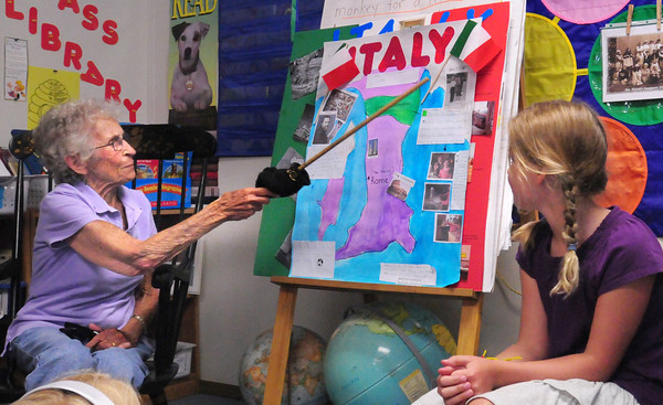 Newburyport: Alice Cronin tells students in Mary Ellen Hoiseth's second grade class, at Bresnahan School as Cronin's great-granddaughter Sydney Turner, right, listens where her family came from in Italy. Children were doing a segment on heritage and Cronin, who's 98 years-old this summer, told about the history of her family coming to America. Bryan Eaton/Staff Photo