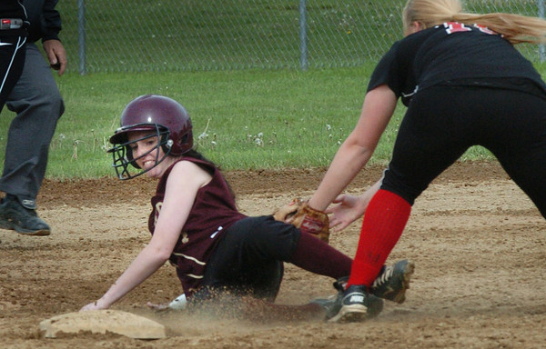 Newburyport: Newburyport's Kendra Dow is safe on second on a hit as North Andover's Angela Logomasini is late with the tag. Bryan Eaton/Staff Photo