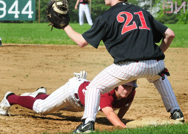 Amesbury: Newburyport's Colby Morris scrambles back to first past Amesbury first baseman Shaun Bannon. Bryan Eaton/Staff Photo