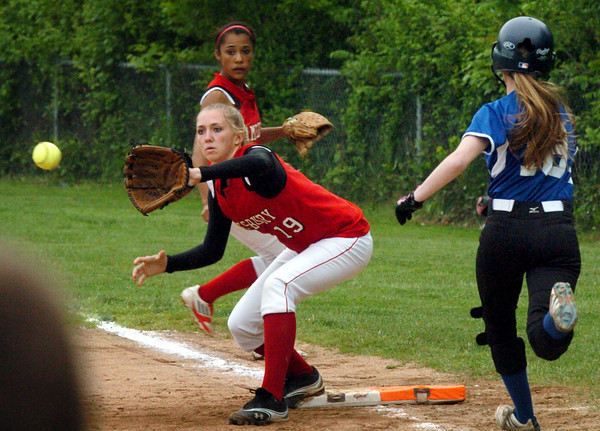 Amesbury: Amesbury first baseman McKenzie Cloutier has her foot on the base forcing out Georgetown's Jen Killian. Bryan Eaton/Staff Photo