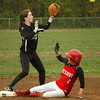 Amesbury: Amesbury's Jenna Bartley makes it to second on a hit by Autumn Kligerman before Pentucket's shortstop (#3) gets the throw. Bryan Eaton/Staff Photo