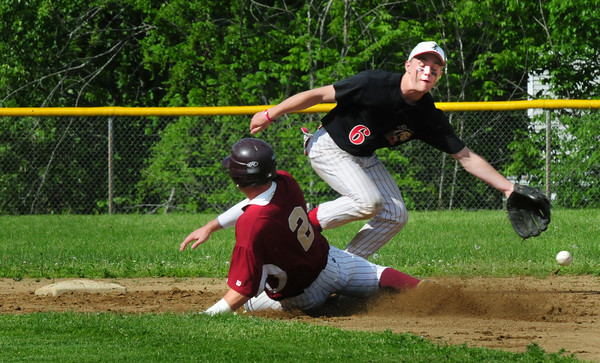 Amesbury: Newburyport's James  Conway steal second base as the ball goes wide of Amesbury shortstop Ben Cullen. Bryan Eaton/Staff Photo