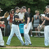 Newburyport: Bishop Fenwick players celebrate getting Newburyport players out in extra innings yesterday. Bryan Eaton/Staff Photo