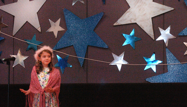 "Amesbury: Loghan Bush as Cinderella starts the opening number ""I Have a Dream"" of the namesake play at the Cashman School in Amesbury on Thursday morning. The first-graders in Patty Bradley and Marcia Stellmach's classes also did a second show at night for parents. Bryan Eaton/Staff Photo"