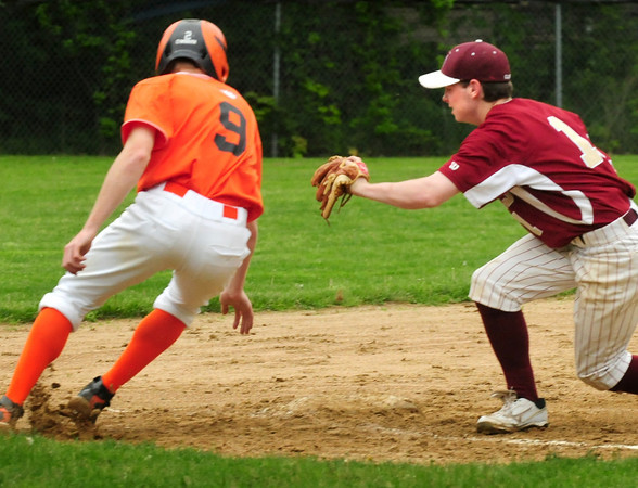 Newburyport: Newburyport third baseman Brian Fiascone forces an Ipwich player out after overshooting the base and heading back. Bryan Eaton/Staff Photo